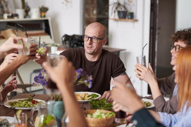 man-wearing-eyeglasses-making-a-toast-3184184